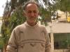 Abu Majdi outside his café
